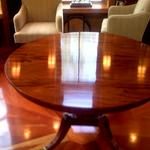 A beautifully french polished mahogany table