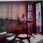 Cliff may at work, french polishing a round conference table.